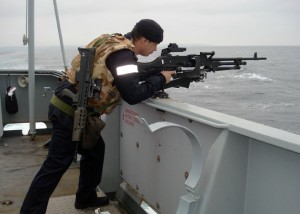 A member of the crew of HMS Enterprise on exercise near Plymouth in May 2014